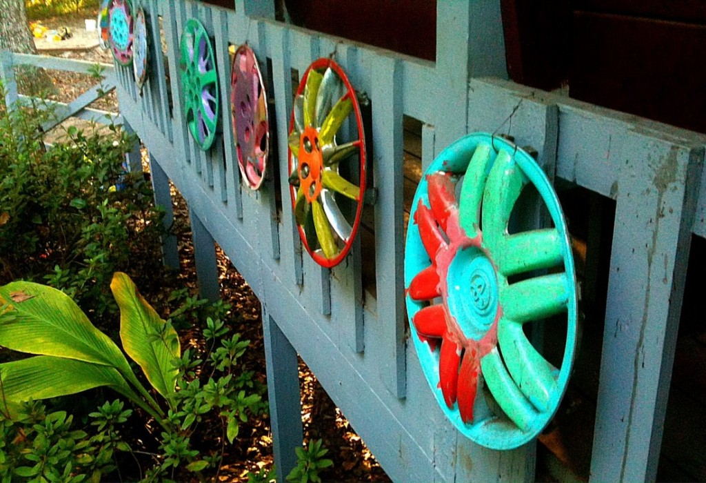 Painted hubcaps that line the school's porch.