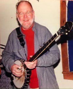 Older man with a banjo.
