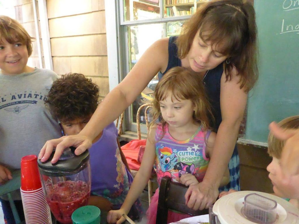 Kerrie helps some students use the blender.